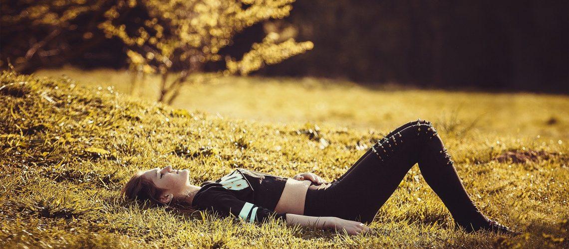 girl-lying-on-the-grass-holistic-list